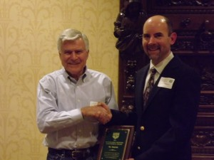 1964 Olympian Vic Zwolak accepts award from Club President Ray Christensen in 2012