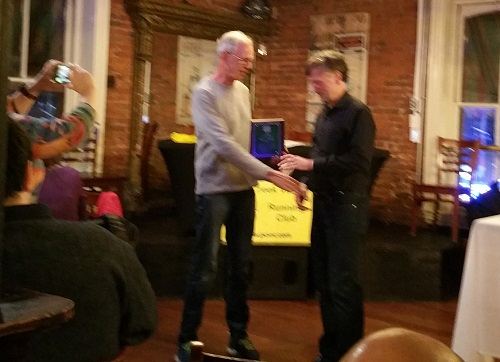 Dirk Sweigart presents award to Robert Mason