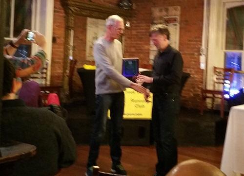 Dirk Sweigart presents award to Robert Mason