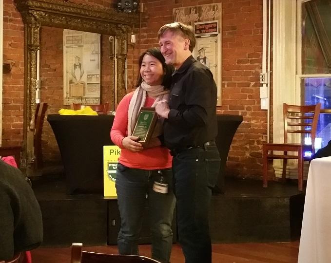Dirk Sweigart presents award to Christina